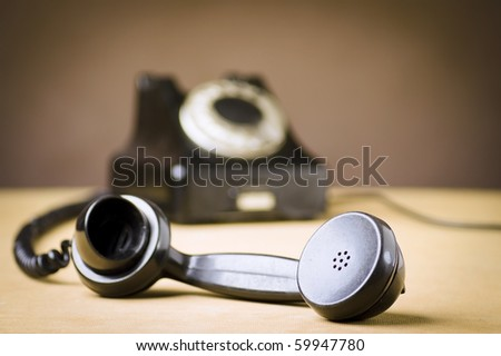 Vintage Rotary Dial Telephone. Soft focus with focus on handset.