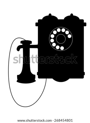 Vintage rotary telephone with a mouthpiece hanging alongside the box with its bells - stock photo