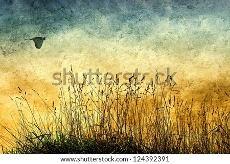 Vintage rural view with wild herbs and flying heron - stock photo