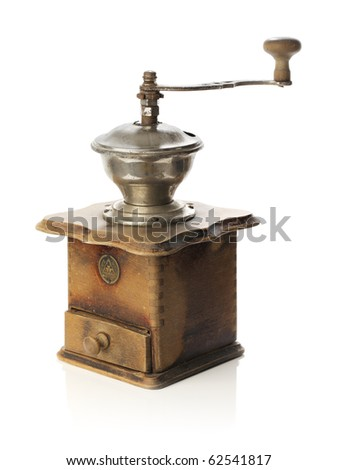Vintage rustic coffee grinder isolated on white with some reflection.