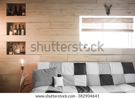Vintage Rustic Flat Old Plank of Wood Wall Perspective with Horns and Whisky Bottles (no logo) Perfect for Painting or Picture Frame Addition - stock photo