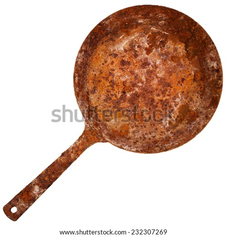Vintage rusty cast iron skillet isolated on white background - stock photo