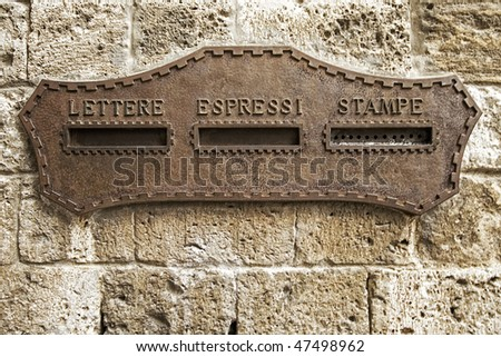 Vintage rusty iron mail box on stone wall at Venice, in Italy - stock photo