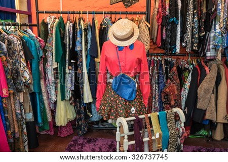 Vintage 1960's and 1970's clothes for sale. - stock photo