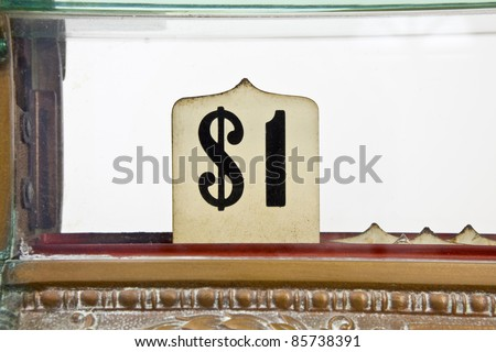 Vintage 1920's cash register pop up dollar sign detail. - stock photo