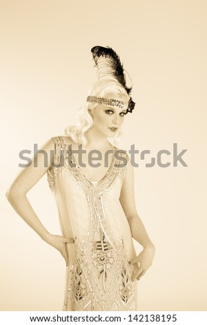 Vintage 1920's flapper girl in sepia tone. - stock photo