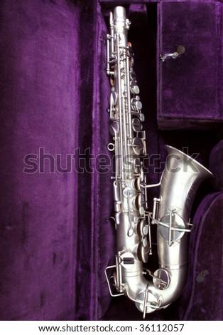 Vintage sax in original case, circa 1924 - stock photo