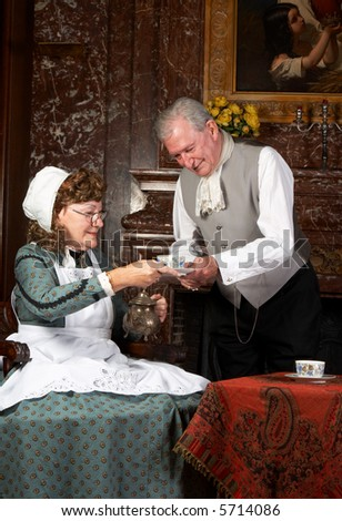 """Vintage scene of a victorian couple having tea. Shot in the antique castle """"Den Brandt"""" in Antwerp, Belgium (with signed property release for the Castle interiors). - stock photo"""