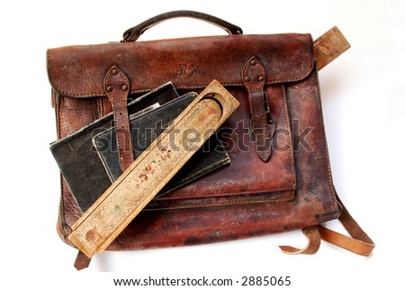Vintage schoolbag with notes and pen-case - stock photo