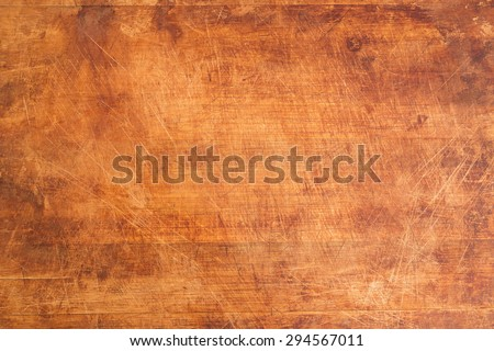 Vintage Scratched Wooden Cutting Board Background Texture - stock photo