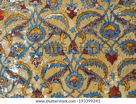 Vintage seamless pattern ornament on old wall - stock photo