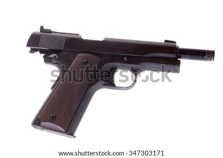 Vintage 1911 semi automatic pistol - stock photo