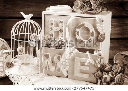 vintage sepia home still life with wooden drawers box,metal cage and roses in romantic style   - stock photo