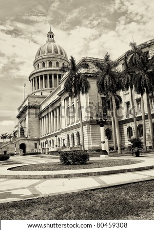 Vintage sepia view of the Capitol of Havana and its adjacent garden - stock photo