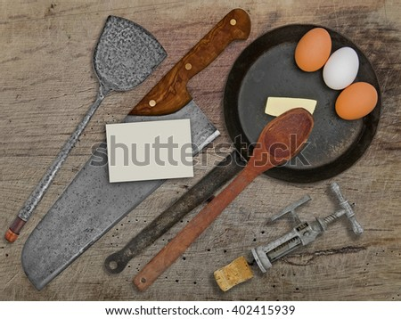 vintage set for frying eggs over wooden table, space on business card for your text - stock photo