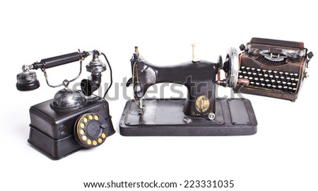 Vintage set. Old telephone, sewing machine, typewriter isolated - stock photo