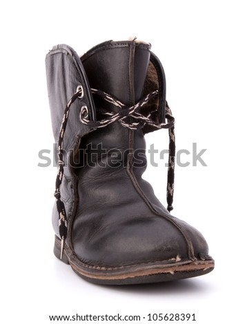 Vintage shabby child's boot isolated on white background cutout