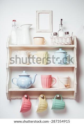 Vintage shelf in the kitchen, shabby chic style, retro toned - stock photo
