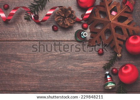 Vintage shiny brite ornaments and pine on a rustic wooden background - stock photo