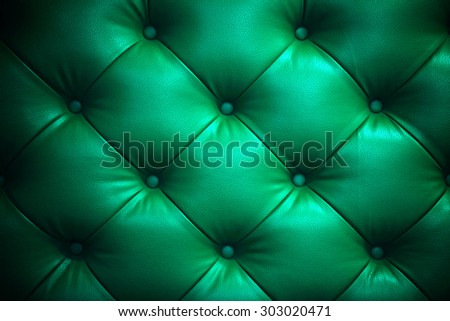 Vintage shiny green leather Sofa Button for textured background - stock photo