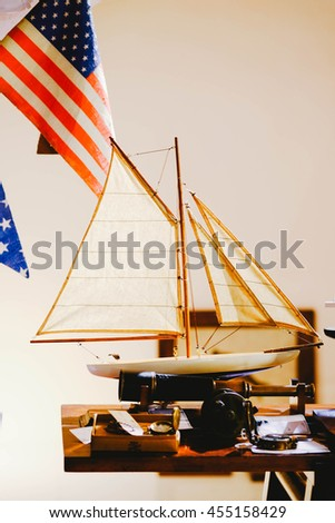 Vintage ship model with the american flag - stock photo