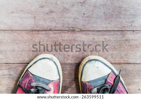 vintage shoes on wooden board - stock photo