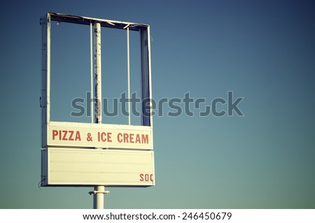 vintage signboard with blue sky - stock photo
