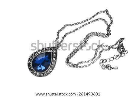Vintage silver sapphire pendant on white background - stock photo