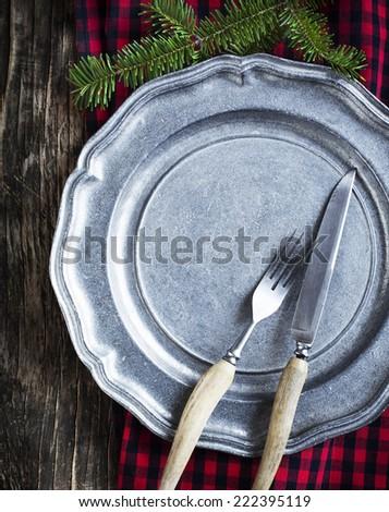 Vintage silverware on rustic metal plate for Christmas Dinner. - stock photo
