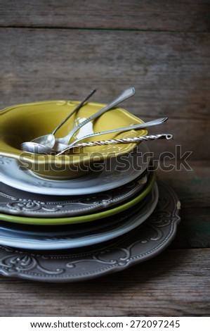Vintage silverware on the old wooden table - stock photo