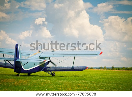 Vintage single-engine biplane aircraft ready to take off - stock photo