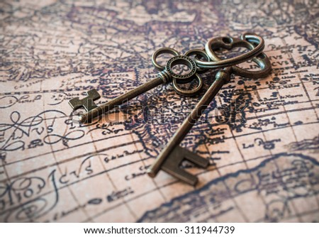 Vintage Skeleton Keys On Antique World Map . - stock photo