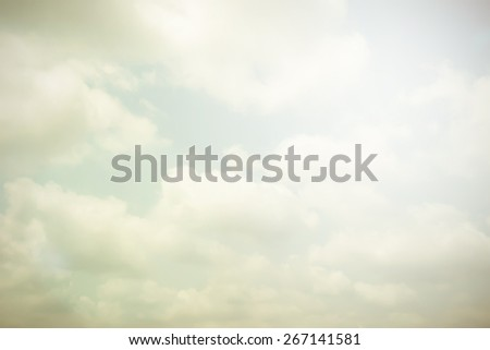 Vintage sky with clouds and light flare  - stock photo