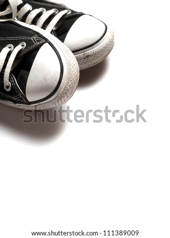Vintage sneakers on white background - stock photo