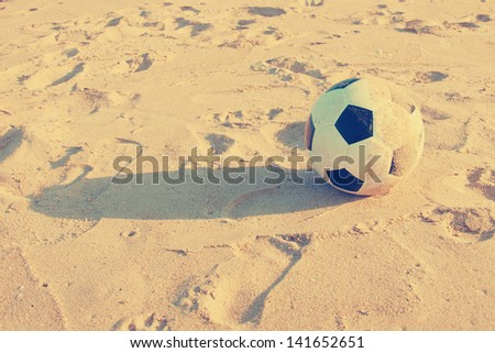 Vintage Soccer ball on sand - stock photo