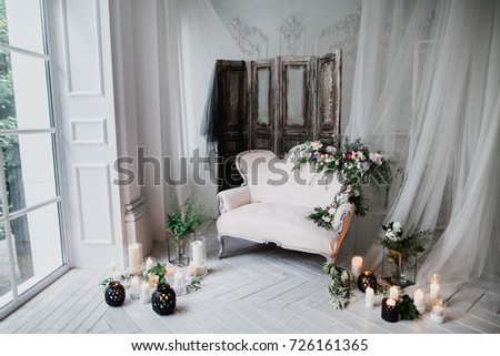 Vintage Sofa Of Soft Pink Color Decorated With Flowers And Greens Stands In A