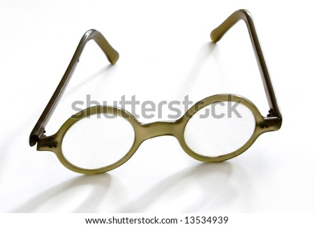 vintage spectacles isolated in white - stock photo