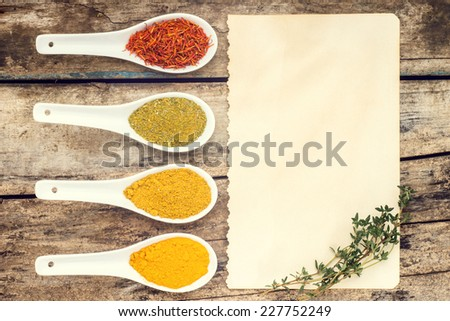 Vintage Spices recipe background. Various condiments with branch of thyme. Top View - stock photo