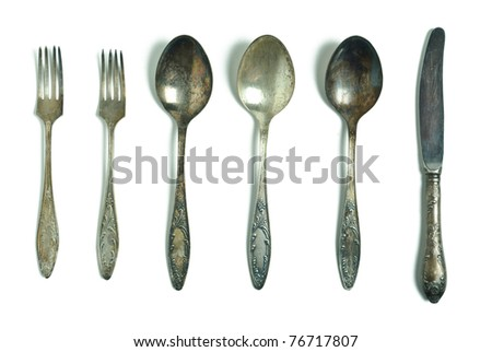 Vintage spoons, fork and knife isolated on white - stock photo