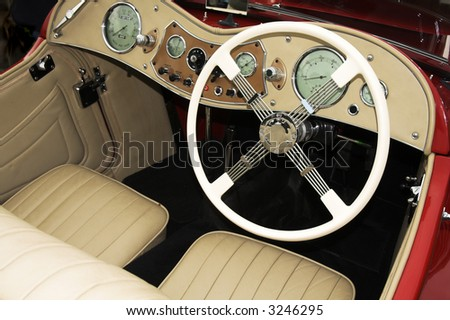 vintage sports car cockpit - stock photo