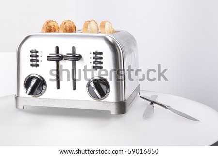 Vintage stainless steel toaster and toasts - stock photo