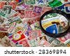 vintage stamp collection with magnifying glass - stock photo