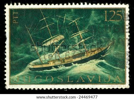 vintage stamp depicting a sailing ship under sail - stock photo
