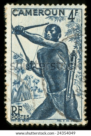 Vintage stamp from Cameroon depicting a tribal hunter with bow and arrow - stock photo