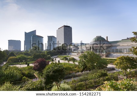 Vintage statues and modern buildings in the park Botanique, Brussels, Belgium  - stock photo