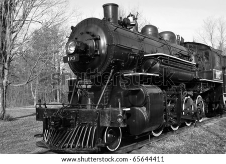 vintage steam engine in black and white - stock photo