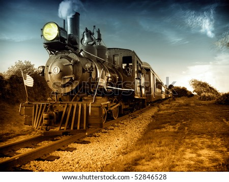 Vintage Steam engine locomotive train moving down railroad track towards camera. American flags on front, Hand painted black and white photograph.