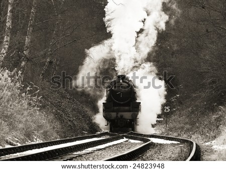 vintage steam train photographed in black and white with identification markings removed - stock photo