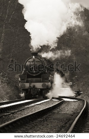 vintage steam train photographed in black and white with no identification markings visable - stock photo