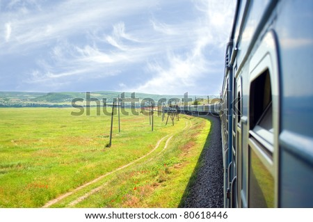 vintage steam train with blue wagons - stock photo